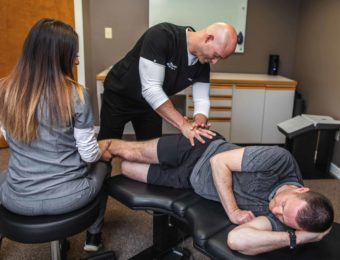 Chiropractor Dr. Brian A. Zelasko Treating Male Patient's Hip At Prime Spine Associates