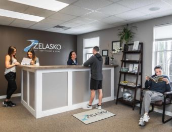 Clean Waiting Room With Patients Within Zelasko Soft Tissue & Spine