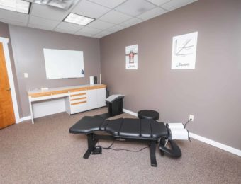 Zelasko Soft Tissue & Spine Clean And Modern Examination Room