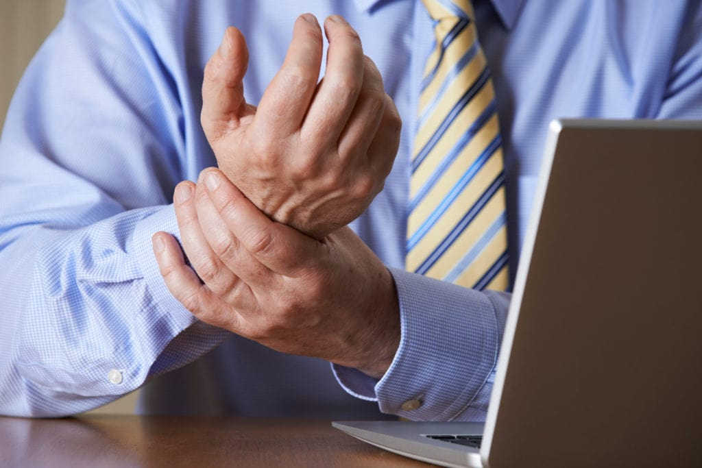 Businessman Suffering From wrist pain